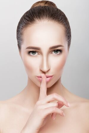 woman showing silence gesture Stock Photo