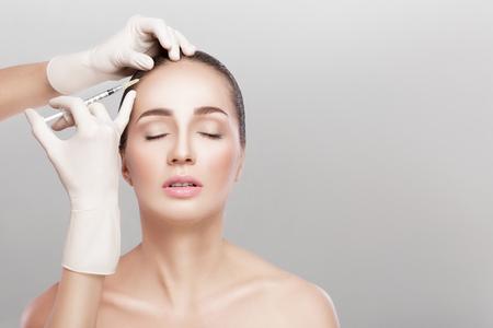 Cosmetic been injected in womans head. Zdjęcie Seryjne