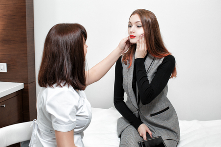 cosmetologist and young woman 스톡 콘텐츠