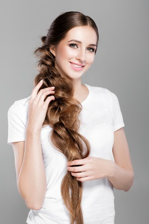 hairstyle braid.  woman with long  hair