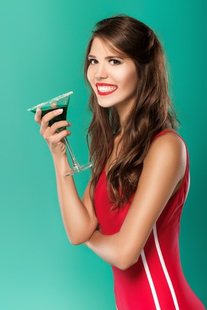 beautiful woman drinks summer cocktail