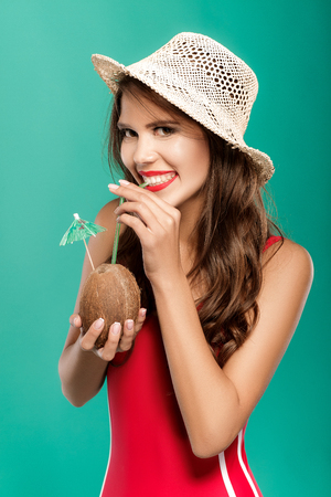woman drinks summer cocktail in coconut Stock Photo