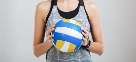 volleyball in the hands of a woman