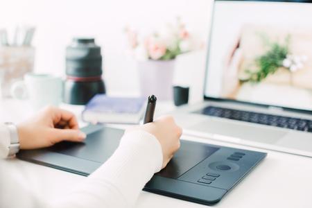 retouching on computer laptop 写真素材