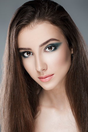 beautiful woman with green evening make-up