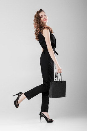 woman in black with shopping bag