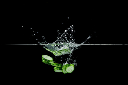 cucumber in water with splash