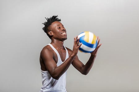 athletic African-American man with volleyball Stock Photo