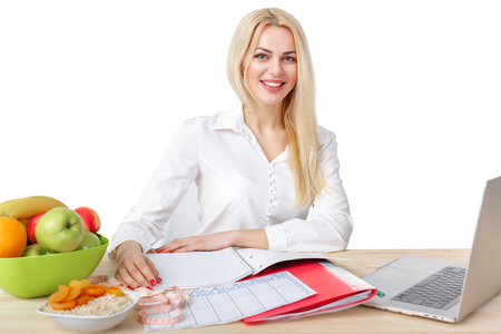 dietician making a diet of fruits and vegetables