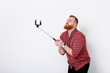 man makes selfie on phone