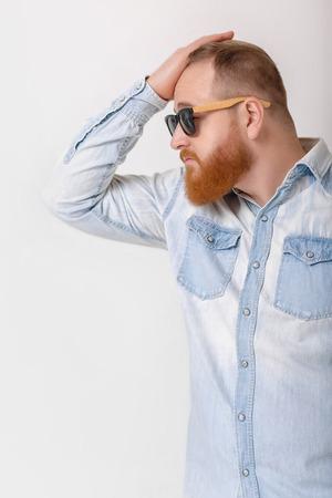 beard man in sunglasses and denim shirt