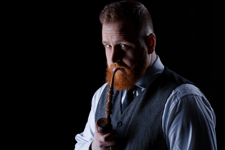 man smoking a pipe 스톡 콘텐츠