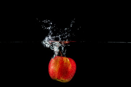 apple in water splash Stock Photo