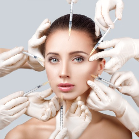 woman getting cosmetic injection 스톡 콘텐츠