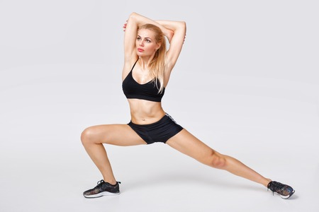 woman in sportswear does exercises Stock Photo