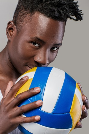 African-American man with volleyball Stock Photo