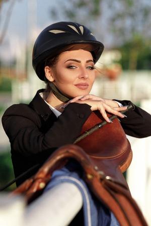 elegant rider woman in helmet with whip Banco de Imagens