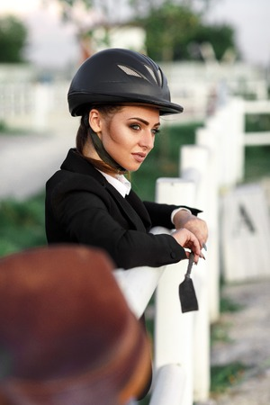 elegant rider woman in helmet with whip Stockfoto