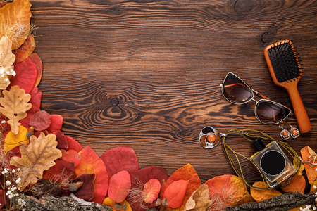 Fashion female accessories Set. autumn leaves, sunglasses, perfume and jewelry
