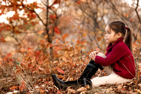 Fashionable kid 5 year old posing in autumn park. Stock Photo