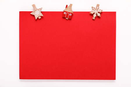 red paper card on a christmas clothes peg