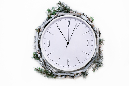 Christmas clock with winter decoration on wall