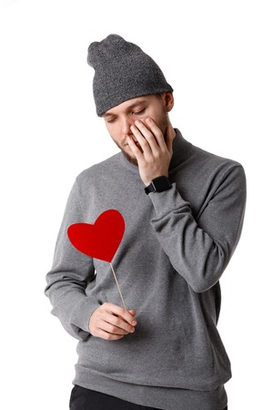 Young happy man holding red paper heart. Stock Photo