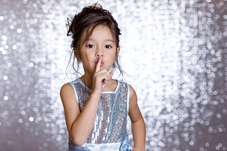 cute smiling little child girl in silver and blue dress 免版税图像 - 115820560