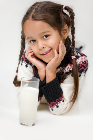 happy cute little child girl with glass of milk isolated on white