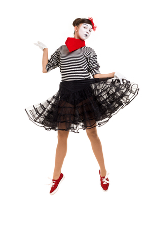 Full length portrait of mime woman artist jumping isolated on white background 写真素材