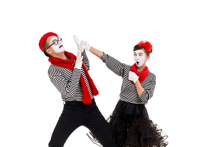 mimes in striped shirts. couple fighting each other for fun isolated on white background