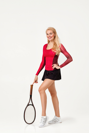 Female tennis player with tennis racket isolated on white background