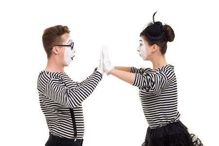 Smiling mimes in striped shirts. Man and woman dressed as actors of pantomime theater isolated on white background