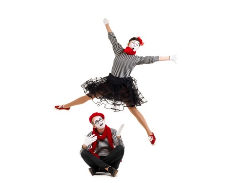 Smiling mimes in striped shirts. surprised man and jumping woman isolated on white background Banco de Imagens