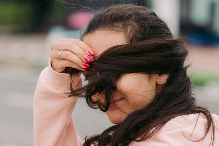 girl covers her face with hair and fooling around