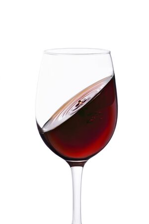 splash of red wine in glass isolated on white background.