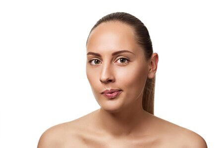 displeased woman looking at camera. model with light nude make-up isolated on white background