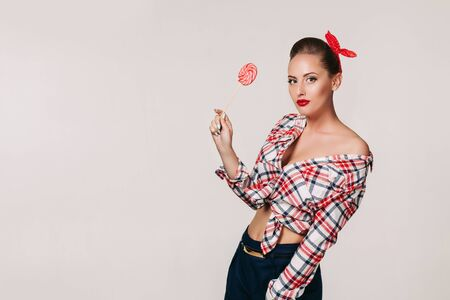 beautiful pin-up woman with lollipop. Copy space for text