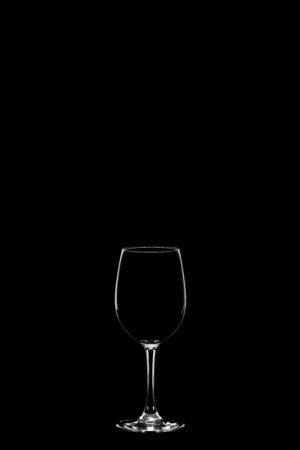 empty wineglass isolated on the black background