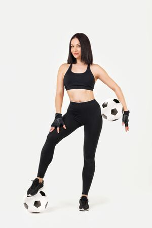 beautiful athletic woman with soccer ball posing isolated on gray background Stock Photo - 128610663
