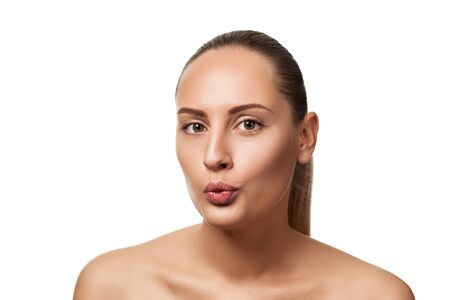 Portrait of cute woman sending blowing kiss with pout lips looking at camera isolated on white background. Stock Photo - 128613178