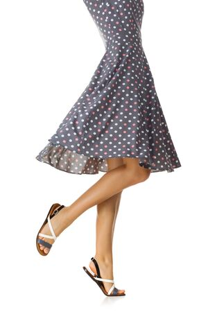 Woman in polka-dot dress standing in shoes isolated on white background. summer Stok Fotoğraf - 128613366