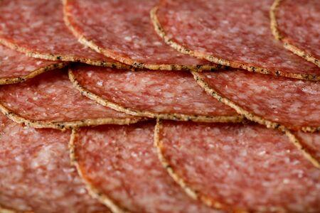 delicious sliced salami sausage . top view