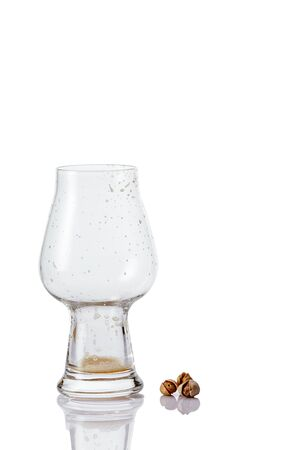 Empty Beer glass with drops on white background. fresh Banco de Imagens