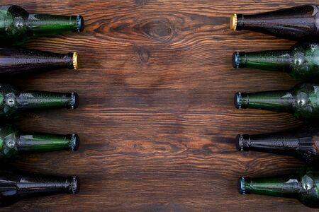 different beer bottles on wooden table . Top view Stock Photo