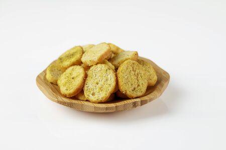 wood plate of crusty bread bruschetta on white background
