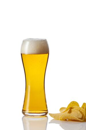 Perfect glass of beer with foam and potato chips on white background