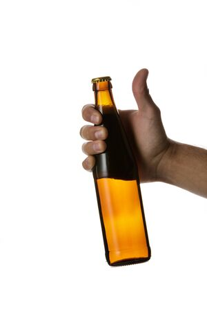 male hand holding brown beer bottle without label isolated on white background