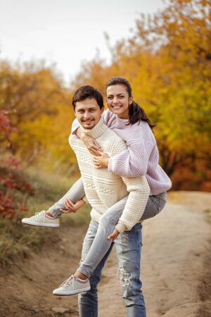 Couple in love having fun in beautiful autumn park. happy moments