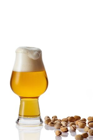 Perfect glass of beer and nuts on white background